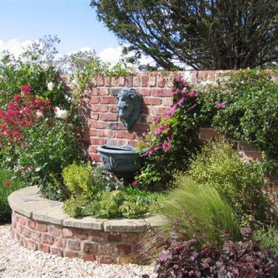 Traditional old walls softened with planting